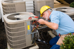 an HVAC contractor fixing a machine