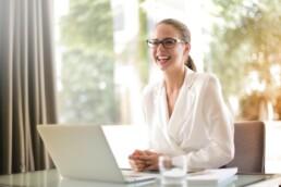 smiling businesswoman on laptop