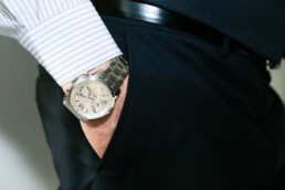 hand in pocket with look at luxury watch